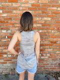 Add a little edge to your wardrobe with this lightweight, relaxed Camo Pocket Racer Tank in Grey by Z Supply Clothing. This women's camo tank is an essential. Made from Hacci Knit, this camo pocket tank features a chest pocket, a racer-cut back, and a V-neckline. Multitudes Boutique. Cutest Online Clothing Store.