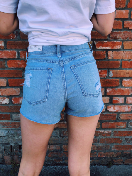 The Light Wash Beach Bum Shorts are our new favorite distressed denim shorts! We love the lighter wash, the high waist, and the distressing throughout! These will be perfect with your favorite graphic tee to run errands. Best Online Boutique. Multitudes Boutique. Free Shipping on most orders. Honeysuckle Tees.