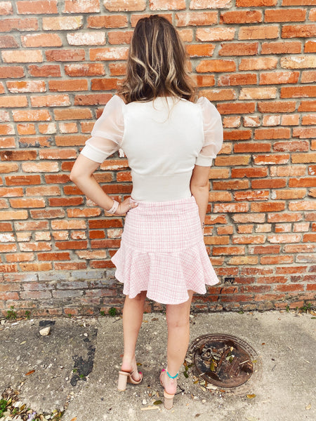 Flounce Skirt at Multitudes Boutique - The Coco Inspired Tweed Flounce Skirt is adorable! This Pink Plaid Skirt is fitted along the waist and hips, then flares out, creating a flounce effect. This is a classic Spring Skirt that belongs in your closet! Multitudes Boutique. Cutest Online Clothing Store.