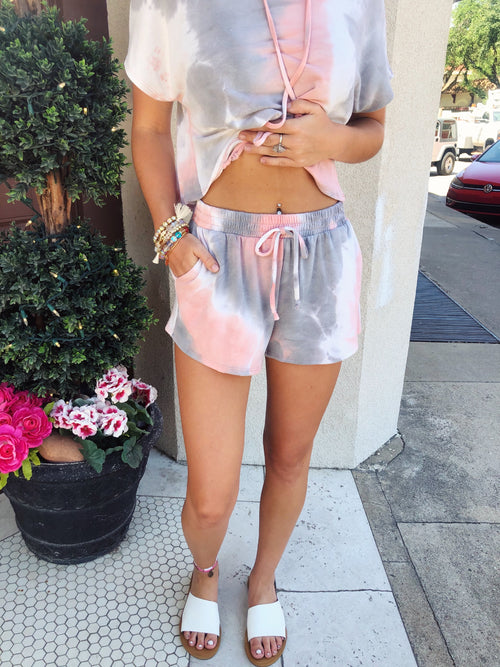 Looking for a Tie Dye Two Piece Set? Then grab these Salmon Tie Dye Lounge Shorts first, then snag the matching crop top hoodie! You can also wear these tie dye shorts with your favorite Honeysuckle Tee! We love two piece sets and know you do too! Multitudes Boutique. Cutest Online Boutique. Honeysuckle Tees.