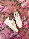 Are you searching for Golden Goose Sneakers, but don't want to pay the price? Check out our White Star Sneakers! They are a Must-have right now! Dress them up with slacks and cute dresses, or dress them down with your favorite distressed denim shorts and vintage graphic tee! Multitudes Boutique. Cutest Online Boutique.