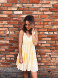 Hey Summer-Lovin Girl! You have to grab this Dripping Yellow Tie Dye Dress! This Tie Dye Dress is as bright and cheerful as you! This happens to be our favorite Tiered Ruffle Dress of the moment and we think you will look smashing in it! Don't you agree? Multitudes Boutique. Cutest Online Boutique. Free Shipping $65.
