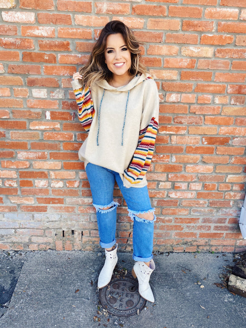 Unique Hoodie at Multitudes Boutique - This Serape Accent Hoodie is an oversized wonder that's as soft as it is cute! You will love the serape accents on the sleeves and inside the hood. Multitudes Boutique. Cutest Online Boutique.