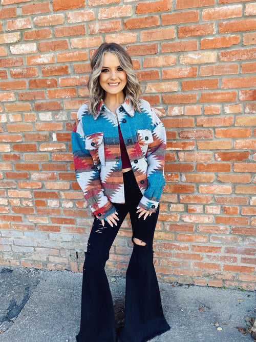 Aztec Jackets for Women at Multitudes Boutique - The Rustic Aztec Print Jacket will be your new crush! Those rusts and turquoise are perfect! This shirt jacket has an oversized collar, oversized front pockets, and is as soft as it is cute! Honeysuckle Tees. Multitudes Boutique. Cutest Online Boutique.