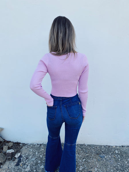 Do you love the Cropped Sweater Trend for Fall? Then snag this adorable Pink Pearl Detail Cropped Sweater! We love wearing pastels when it's cool, and just picture how cute you will look when you wear this little cropped sweater with your mom jeans, flares, and skorts! Multitudes Boutique. Cutest Online Boutique.