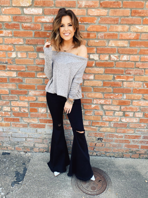 Off Shoulder Tops are trendy and this Grey Off the Shoulder Dolman Top is a must! You'll love the soft fabric, the heather grey color, and the stylish dolman sleeves. The stretchy neckline allows you to wear it up on your shoulders, off one shoulder, or off both shoulders. Multitudes Boutique. Cutest Online Boutique.