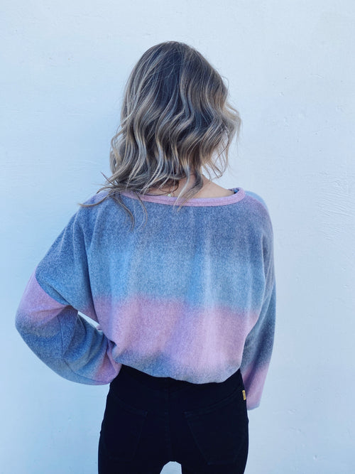 Cropped Sweatshirt at Multitudes Boutique - The Pink Ombre Brushed Knit Top is an amazingly cute lounge top! You will love the ombre effect of this brushed knit that goes from grey, pink, to light blue! It's made of soft hacci knit so it's super cozy and comfy. Crop Top. Multitudes Boutique. Cutest Online Boutique.