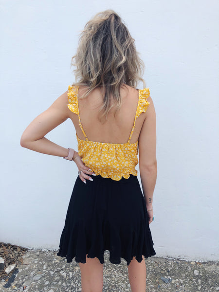 Don't you love Yellow Crop Tops? Then take a peek at this adorable Knotted Floral Ruffle Crop Top! Ditsy Floral Crop Tops are so trendy this summer, and the Floral Crop Top is the cutest one we've seen! It's bright and cheery, just like you! Multitudes Boutique. Cutest Online Boutique. Summer 2020 Trends. Free Ship.