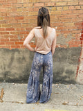 Pair The Jasmine Palazzo Pants in Navy with your favorite white tee or crop top for an easy, summer day look! These Wide Leg Palazzo Pants are navy with a jasmine floral print. These Floral Pants also feature a high waist and a tiered diagonal hemline. Made in the USA. Multitudes Boutique. Cutest Online Clothing Store.
