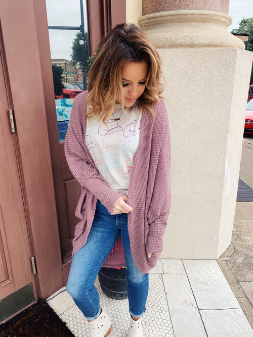 Love a great Batwing Cardigan? Then snag this Mauve Waffle Knit Cocoon Cardigan! You can wear this cardi over graphic tees, tank tops, and crops. You can wear it out or while lounging in. It's versatile and cute and you will be so glad you snatched it up! Cocoon Cardi. Multitudes Boutique. Cutest Online Boutique.