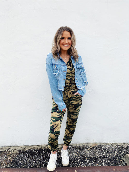 Love a Camo Print Jogger Jumpsuit? Then snag this Camo Print Sleeveless Hooded Jumpsuit! Whether running errands or lounging at home, you'll be comfy in this jogger jumpsuit! And, for a cute fall transitional outfit, picture this camo hood peeking out of your denim jacket! Multitudes Boutique. Cutest Online Boutique.