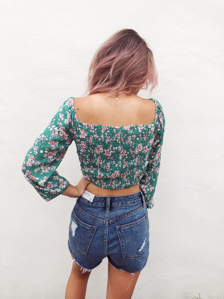 Love the trend of the Drawstring Top? Then check out this Green Ditsy Ruched Drawstring Top! Ditsy Floral Crop Tops are the rage, and this Drawstring Top does not disappoint! We know you will love the details on this Drawstring Crop Top! Multitudes Boutique. Cutest Online Boutique.