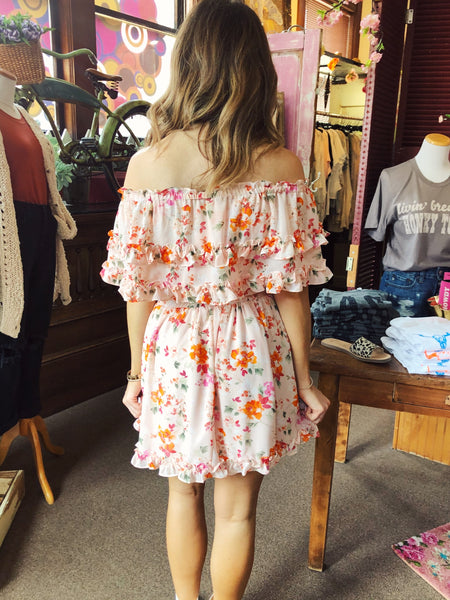 The Pinky Promise Dress just screams sunny days and sunday dinners with family! Can't you just picture yourself? We are totally in love with the pretty pink and orange floral print, and those tiny ruffles at the hem and along the bodice are sweet and feminine. Best Online Boutique. Multitudes Boutique. Free Shipping on Orders