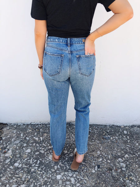 Distressed Mom Jeans are trending and you need these Distressed Hem Mom Jeans for your back-to-school wardrobe! These High Waisted Mom Jeans are made of that perfect light washed blue denim, and have some distressing. Grab these Mom Jeans while you can. Honeysuckle Tees. Multitudes Boutique. Cutest Online Boutique.