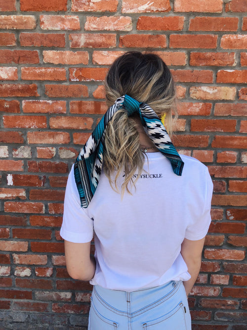 "Y'all, The Casey Wild Rag is the NEXT TRENDY ACCESSORY to add to your wardrobe!! This bandana sized scarf has a satin feel. Tie it up in your hair like we showed here, or tie it around your hat, your neck, your wrist, or your purse strap! The Casey Wild Rag will add a little zing to any outfit! 19.5"" x 19.5"" 100% Polyester. Best Online Boutique."
