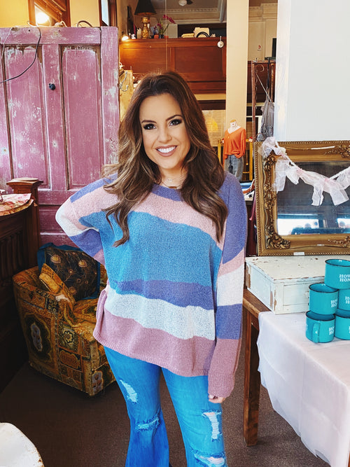 Lightweight Sweater at Multitudes Boutique - The Painted Desert Sweater is stunning! This Oversized Knit Sweater has abstract colored stripes. This Lightweight Sweater has a slightly oversized neckline, and will be perfect to take you into Spring! Multitudes Boutique. Cutest Online Clothing Store.