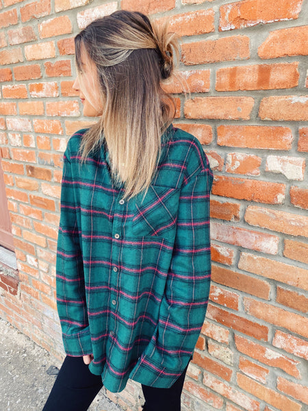 Green Flannel Shirt by Multitudes. This Green Plaid Boyfriend Flannel is a classic! This women's green flannel shirt is oversized, soft, and has hunter green, black, and red plaid. This Green Flannel Shirt is perfect for everyday or Family Holiday Photos! Multitudes Boutique. Cutest Online Boutique. Honeysuckle Tees.