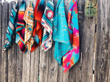 Y'all, The Annie Wild Rag is the NEXT TRENDY ACCESSORY to add to your wardrobe!! This bandana sized scarf has a satin feel. Tie it up in your hair like we showed here, or tie it around your hat, your neck, your wrist, or your purse strap! The Annie Wild Rag will add a little zing to any outfit! 19.5
