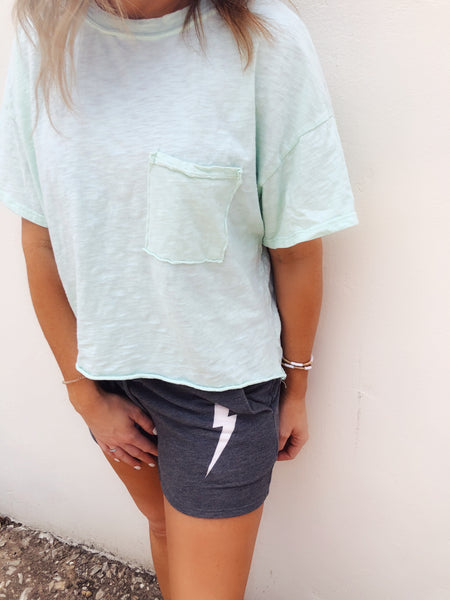 We love an Oversized Cropped Tee, and this Mint Oversized Cropped Pocket Tee fits the bill! We LOVE it! The soft slub knit is lightweight, the color is just yummy, and all those raw edges are fun! This Cropped Tee is a great basic and one you'll be so thankful you snagged! Multitudes Boutique. Cutest Online Boutique.