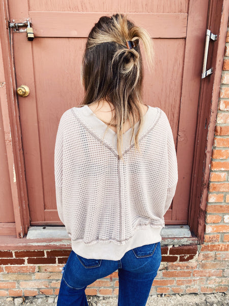 Waffle Knit Shirt by Multitudes. This Dove V-Neck Waffle Knit Shirt is a great basic! The Waffle Knit is a bit oversized and of high quality. The Oversized V-Neck Sweater can be worn on or off the shoulder. Snag this Oversized Waffle Knit Shirt before it's gone! Multitudes Boutique. Cutest Online Boutique.
