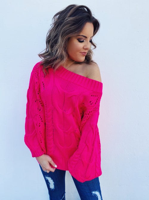 Off the Shoulder Sweater at Multitudes Boutique - The Fuchsia Oversized Cable Knit Sweater is stunning! First, that bright hot pink! What a head-turning color! And, that oversized cable! Add the Off the shoulder style, and this sweater is a winner! Multitudes Boutique. Cutest Online Boutique.