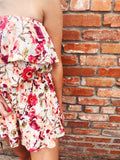 This Floral Tube Romper isn't just your basic summer romper. This Rosey Floral Strapless Tube Romper is special! Girl, look at this adorable strapless romper! It is covered in a floral print of bright coral and yellow roses, and you NEED it! What a beautiful summer outfit! Multitudes Boutique. Cutest Online Boutique.