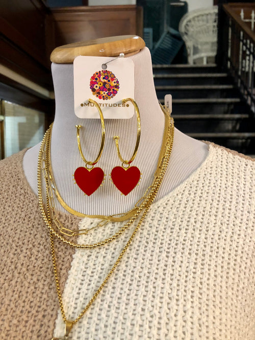 "Heart Earrings at Multitudes Boutique - The I Heart You Earrings are adorable! These Gold Heart Earrings have a gold hoop and red enamel dangle hearts! Approximately 3"" Long. Red Enamel Heart Charms. Orders over $75 ship for FREE! Multitudes Boutique. Cutest Online Clothing Store."