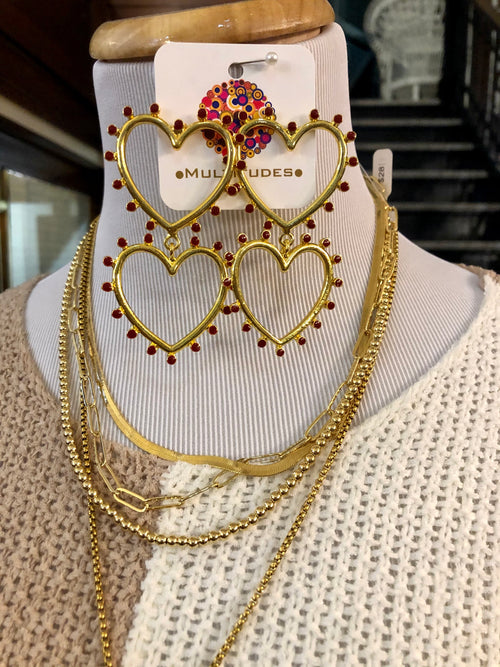 "Gold Heart Earrings at Multitudes Boutique - The Spiked Heart Earrings are a fun statement piece! These Heart Earrings have red dots surrounding two gold hearts. Approximately 2.5"". Orders over $75 ship for FREE! Multitudes Boutique. Cutest Online Clothing Store."