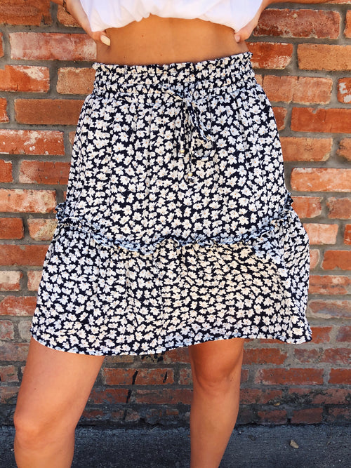 Are you looking for a cute Ditsy Floral Skater Skirt? Well check out this Navy Ditsy Floral Mini Skirt! We love the Tiered Ruffle Skirt Trend and this Ditsy Floral Mini Skirt is at the top of our wishlist! Girl, you need it! How cute will this be for all those Fourth of July Celebrations? Multitudes Boutique.