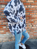 Cow Print Shirt at Multitudes Boutique - The Cow Print Pullover is fun! Cow Print Fabric is trending, and this lightweight sweatshirt is a great way to incorporate Cow Print into your wardrobe! Snag this fun Cow Print Shirt and put a smile on every face you see! Multitudes Boutique. Cutest Online Clothing Store.