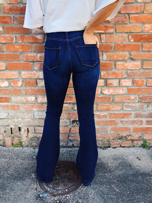 "The thing about the Brittany Button Fly Flares is...you just have to try them to believe it!! They are the most comfortable pair of flares around, fitting more like a legging than a jean, and they make every body type look, well, BETTER! I mean, they are AMAZING! The back pocket is a true pocket and that deep wash goes with so much! Grab your favorite graphic tee, boho cardi, flat billed hat, and you're off to have a great time while looking even greater! Runs true to size. Model is 5'4"" and wearing size 5"