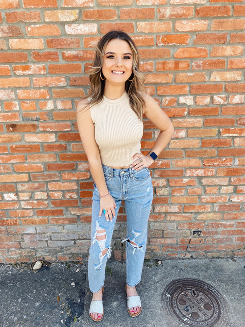 The Cassie Crewneck Crop Sweater in Sand will take you from dressy to casual in a flash. Wear this Sleeveless Sweater with denim or a cute skater skirt. This Fitted Sweater is ribbed, and has a crew neckline. Multitudes Boutique. Cutest Online Clothing Store.