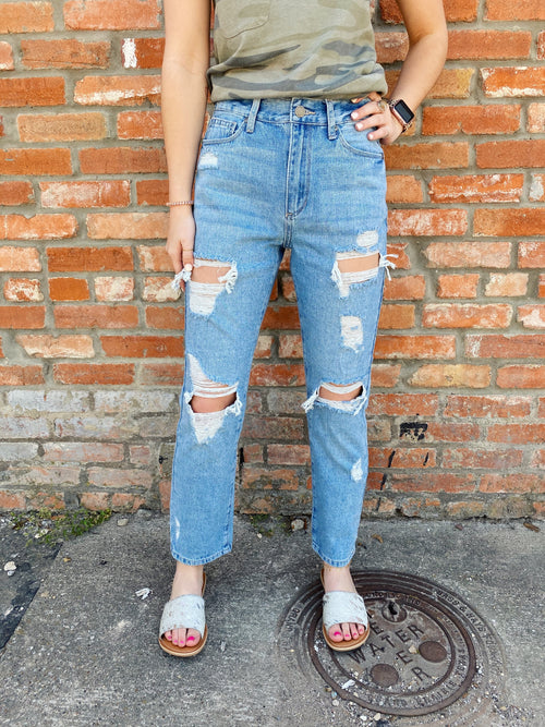 Combining a throw-back fit with updated distressing, the Georgia Super Distressed Girlfriend Jeans are a must! These Distressed Straight Leg Jeans feature a high waist, a relaxed fit, and distressing. Pair these Ankle Length Jeans with a tee for an easy casual look! Multitudes Boutique. Cutest Online Clothing Store.