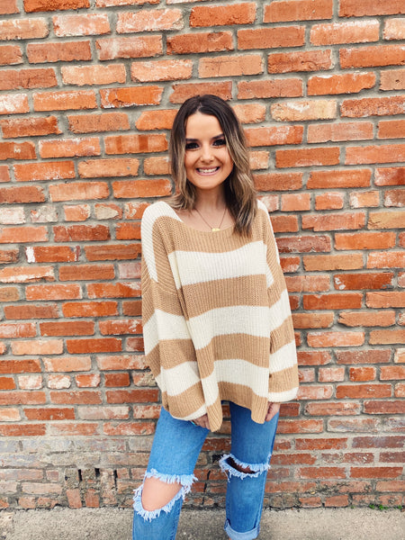 Love an Oversized Sweater? Then snag this Cream and Beige Striped Sweater! This is your new favorite sweater this fall! You need it to wear with you distressed shorts or flares! Oh, and don't forget to pop it off your shoulder! Oversized Sweater by Multitudes. Multitudes Boutique. Cutest Online Boutique.