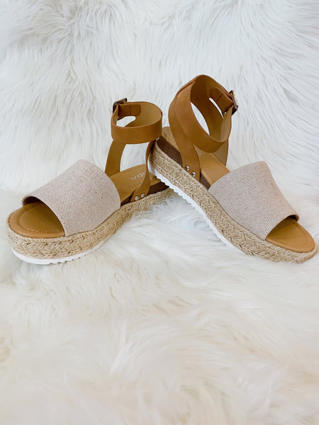 Flatform Espadrille Sandals at Multitudes Boutique - The Topic Mixed Tan Platform Sandal is a great basic! This Espadrille Platform Sandal has a jute base, a burlap look strap across the toes, and an  ankle buckle strap. Wear these Platform Wege Sandals on repeat! Multitudes Boutique. Cutest Online Clothing Store.
