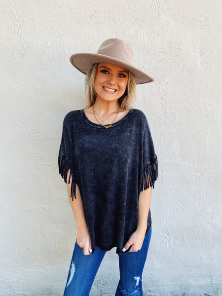 Fringe Tops are fun, and this Charcoal Fringe Sleeve Top is the cutest we've seen! We love the wash of this super soft black tee! This fringe tee is oversized and comfy! Our favorite part  is the fringe on each sleeve! Trust us, you will LOVE this mineral washed tee! Multitudes Boutique. Cutest Online Boutique.