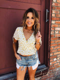 Ditsy Floral Tops are trending this summer, and this Ivory Ditsy Floral Wrap Top needs to be on the top of your list! Not only does this cute ditsy floral top have that cute yellow ditsy floral print, but its a true wrap top that is so flattering! Multitudes Boutique. Cutest Online Boutique. Free Shipping over $65.