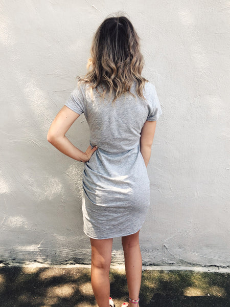Looking for a Bodycon T-shirt Dress? Then you will LOVE the Gray Ruched T-Shirt Dress! This ruched t-shirt dress fits perfectly, not too tight and not too loose. It's soft, flattering, and can be dressed up or down. This Ruched Tee Shirt Dress is too perfect to pass up! Multitudes Boutique. Cutest Online Boutique.
