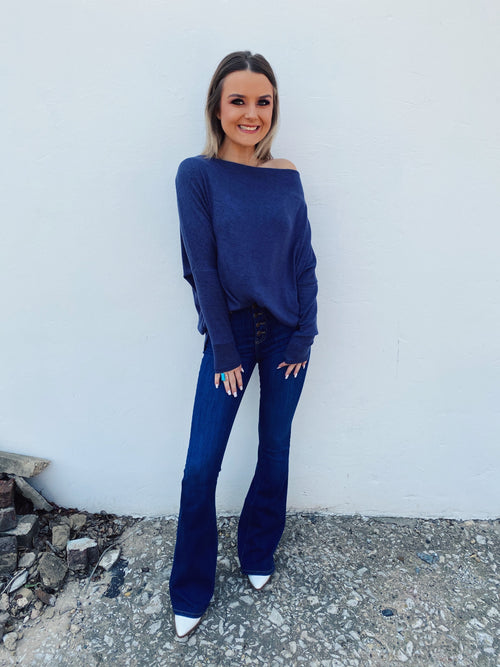 Girl, so you LOVE an Off Shoulder Top? Then snag this Navy Off Shoulder Dolman Top for Fall! Wear this oversized top up on your shoulders during the day, then pull it off the shoulder and throw on your skinnies for night! This Dolman Off Shoulder Top is a MUST-HAVE for fall! Multitudes Boutique. Cutest Online Boutique.