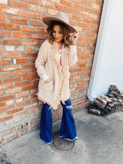 Are you looking for a new Boho Cardigan? Then grab this Pink Sparkle Cardigan with Fringe! This Cardigan with Fringe is STUNNING! Pair it with your flares, your favorite Honeysuckle Tee, and White Booties for a punchy boho look! Honeysuckle Tees. Multitudes Boutique. Cutest Online Boutique.