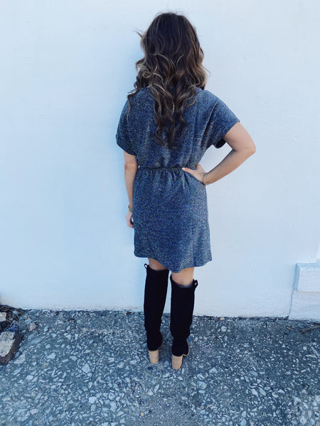 Silver Sparkle Dress by Molly Bracken at Multitudes Boutique - The All the Silver Sparkles Dress is a MUST for your next party ! This mini sparkly dress has dolman sleeves, an elastic waist, and a button keyhole closure. Snag this sparkle dress and pop the champagne! Multitudes Boutique. Cutest Online Boutique.