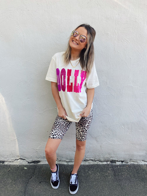 Are you digging the new High Waisted Cheetah Biker Short Trend? Then snag these cute Light Leopard Biker Shorts! Of course, they're super comfy, but look how cute they are with the Honeysuckle DOLLY Tee! Girl, you NEED this whole outfit! Honeysuckle Tees. Multitudes Boutique. Cutest Online Boutique. Boho Graphic Tees.