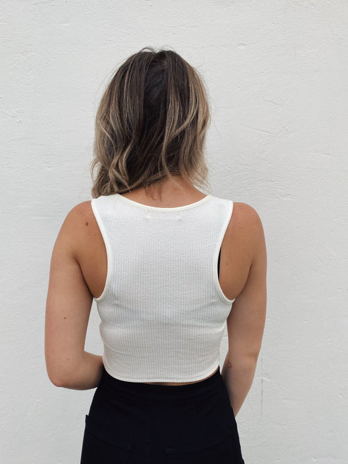 This Sleeveless Crop Top is a soft ribbed knit and is v-necked. This white crop top is a MUST-HAVE for your 2020 Fall Wardrobe! You can dress it up, dress it down, and layer it under jackets and flannels! You will LOVE the way this sleeveless crop top feels and fits! Multitudes Boutique. Cutest Online Boutique.