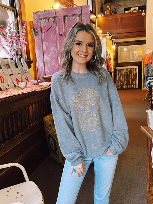 Skull Sweatshirt at Multitudes Boutique - The Gold Stud Skull Pullover is a favorite! This heathered grey oversized sweatshirt is soft, cozy, and lightweight. The Gold Studded Skull on this Skull Sweatshirt is subtle, just the right amount of flashy! Multitudes Boutique. Cutest Online Clothing Store.