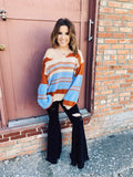 Multicolored Sweater at Multitudes Boutique - The Multicolored Striped Sweater is such a fun look! We love the mix of tan, rust, and light blue! This striped sweater is a bit oversized and has a v-neck. Wear this multicolored sweater on or off the shoulder. Multitudes Boutique. Cutest Online Boutique.