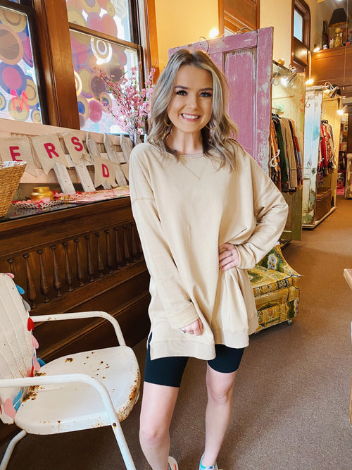 Lounge Tops at Multitudes Boutique - This Tan Basic Everyday Pullover is perfect to go into spring! This Oversized Sweatshirt for Women is a neutral tan color, is longer in length, and has small side slits. Oh, and this Lounge Top is also soft and cozy! Multitudes Boutique. Cutest Online Clothing Store.