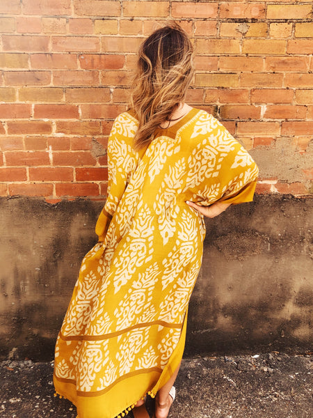 So you love the boho chic look? Then you've gotta grab this Mustard Damask Pom Pom Kimono! This one is a Must-Have that you can wear all year long. From the pool as a cover-up or over your distressed denim shorts and white crop top, it's simply stunning. Multitudes Boutique. Cutest Online Boutique.