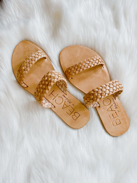 The Tulum Natural Braided Sandal by Matisse is defined by its simple summer elegance. This Slide Sandal is made of leather that is not chemically treated. This Open Toe Sandal is highlighted with beautiful double woven straps. Fits True to Size Leather Upper. Multitudes Boutique. Cutest Online Clothing Store.