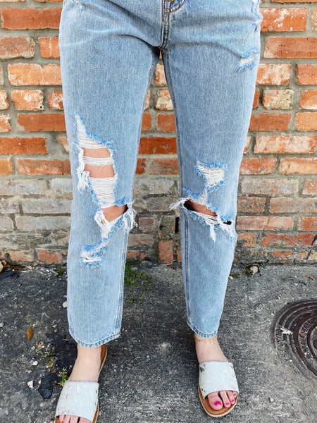 Uplevel your jeans with the Charlotte High Rise Girlfriend Jeans. These Distressed Straight Leg Jeans feature a light wash, a high waist, a relaxed fit, and some distressing. Pair these Ankle Length Jeans with just about any top for an updated, trendy look. Multitudes Boutique. Cutest Online Clothing Store.