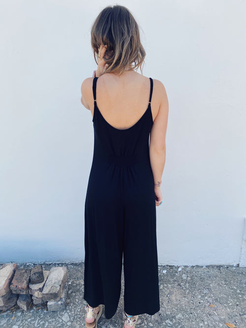 Z Supply Clothings Flared Jumpsuit is now has a smocked waist in back! The Summerland Sleek Jumpsuit is made of Sleek Jersey knit fabric, and features adjustable straps. Pair this Loose Jumpsuit with your favorite sandals to complete the look! Multitudes Boutique. Cutest Online Clothing Store.